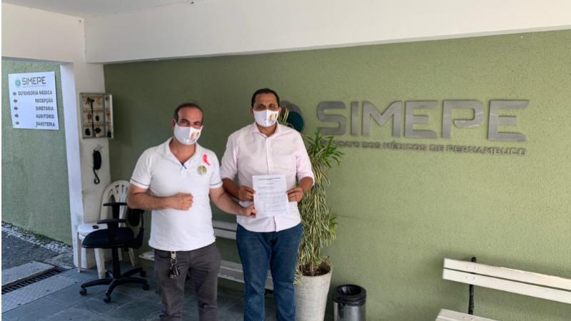 Candidato a prefeito e seu vice, estiveram na sede do SIMPEPE onde firmaram o compromisso